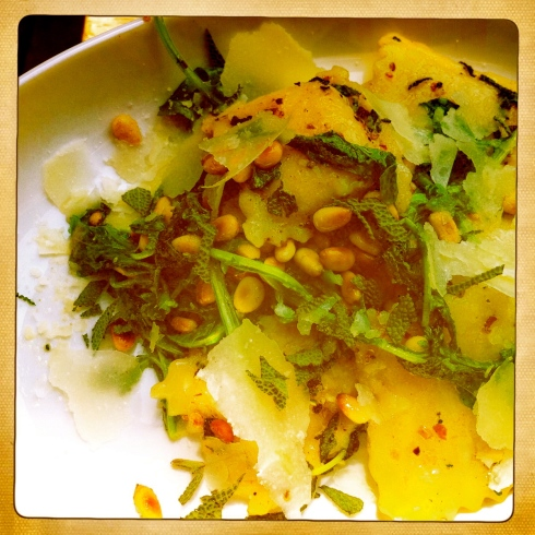 Cheese Ravioli in a Butter Sage Sauce with Wilted Arugula and Toasted Pine Nuts